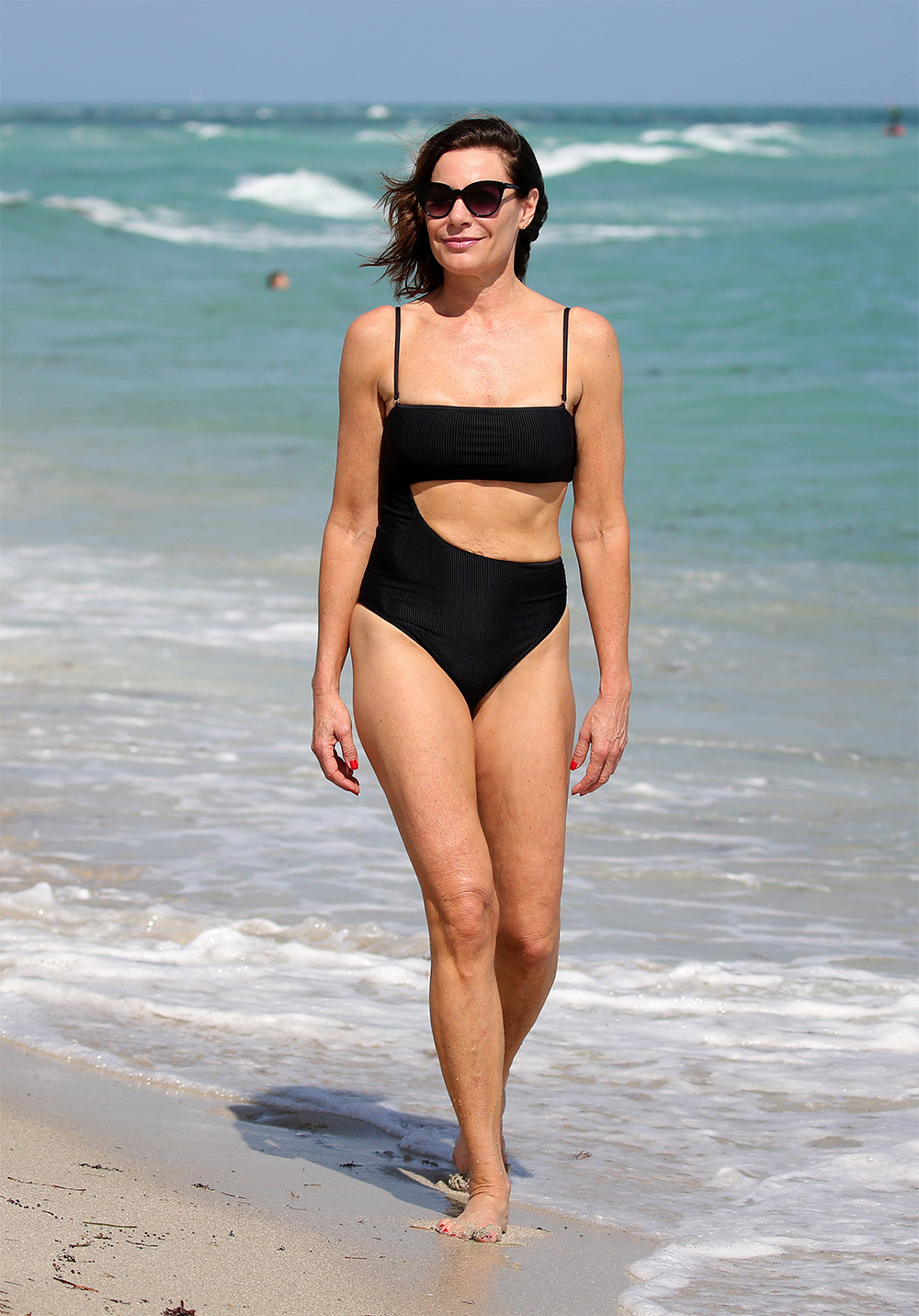 Real Housewives of New York star Luann de Lesseps looks amazing in a black bikini on the beach in Miami